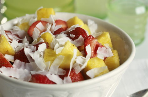 Fresh fruit salad with coconut flakes