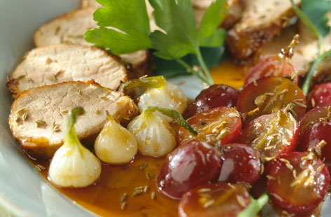 Roast pork with cumin, grapes and onions