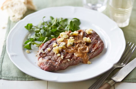 Ribeye steak with blue cheese sauce