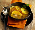 Orange fruit salad with cinnamon and mint