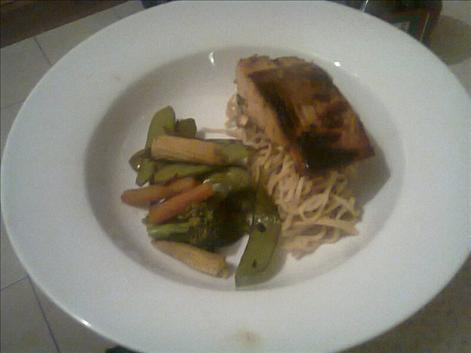 Asian salmon with stir fry vegetables and noodles