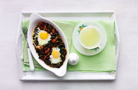 Baked eggs with tomatoes and black kale