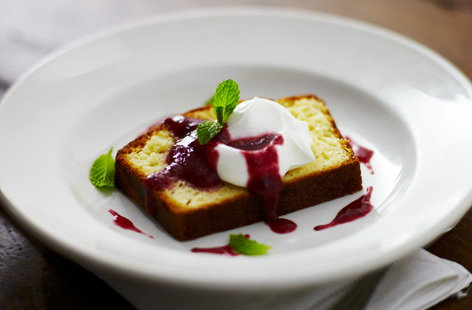 Soured cream pound cake with mixed berry coulis