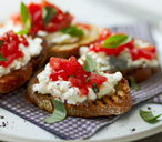Tomato crostini topped with cottage cheese