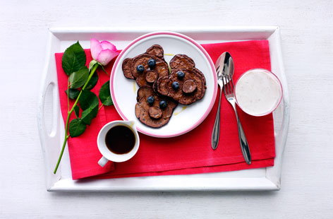 Chocolate mini teddy bear pancakes with berries and syrup