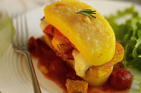 Polenta stacks with peppers, squash, tomato and mozzarella