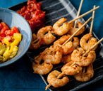 Prawn skewers with tomato chutney and roast peppers(t)
