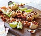 Scallop and prawn kebabs with lime dressing