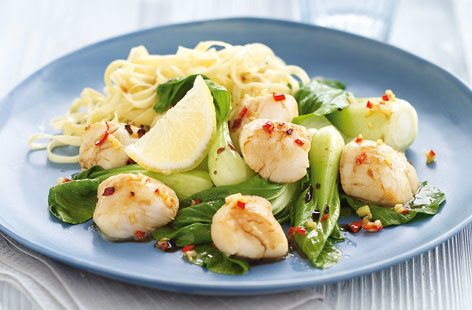 Scallops on wilted pak choi