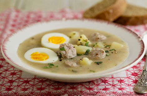 Sour rye soup with egg and sausage