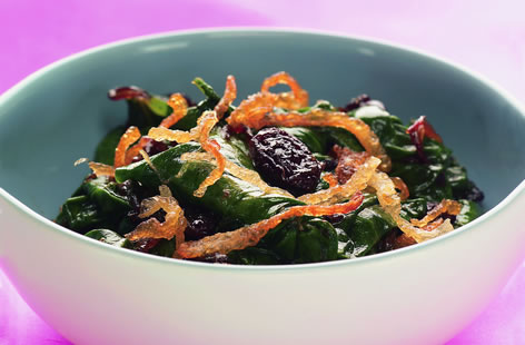 Spinach with caramelized onions and sultanas