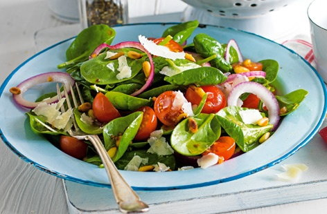 Spinach salad with warm lemon and garlic dressing