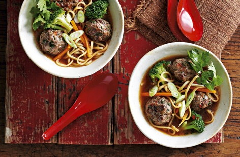 Thai-style meatballs in a noodle and vegetable broth