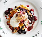 Waffles with a berry compote, cinnamon, yogurt and nuts