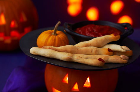 Cheesy witches' fingers with bloody dip
