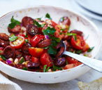Tomato, red onion and chorizo salad