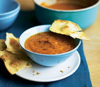 Curried carrot soup with cumin tortilla snaps