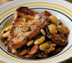 Griddled pork with butterbean and chorizo stew