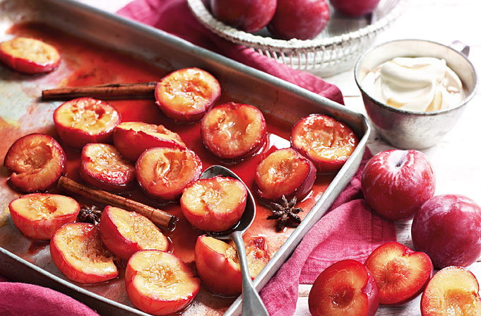 Spiced roast plums with earl grey cream