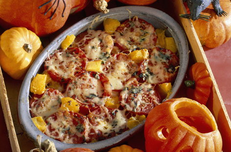Celebrate Halloween with this hearty bake, which is bursting with flavour. The savoury flavours of the pumpkin are great when roasted with sweet tomatoes. Melt some cheddar on top for some oozy, cheesy goodness.