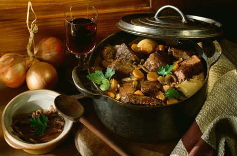 Beef and carrot stew in casserole dish