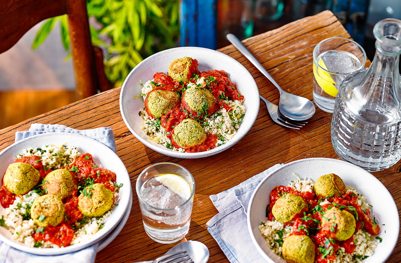 Tomato falafel traybake with lemony couscous recipe