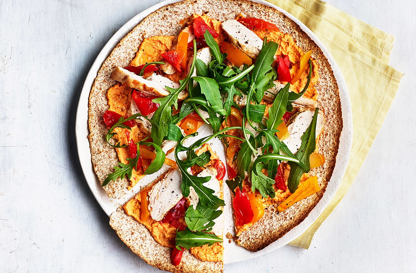 Spiced houmous and chicken 'pizzas' recipe