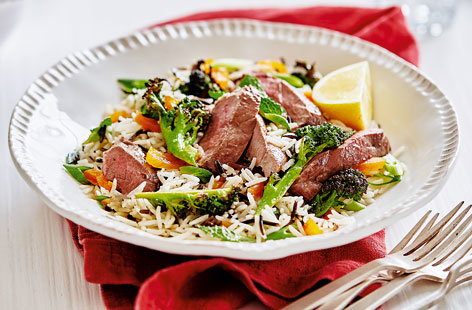 This quick and simple lamb dish with wild rice and apricot salad is a fuss-free, flavour packed family recipe that's good for you too.