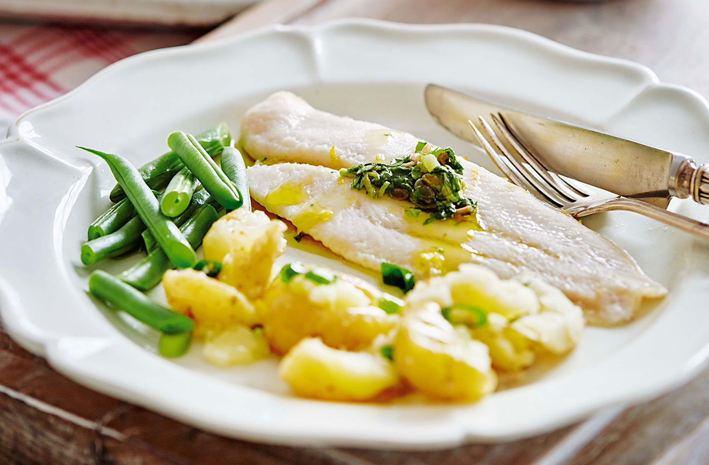 Baked fish with watercress salsa and crushed potatoes recipe