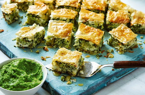 Savoury broccoli baklava served alongside a vibrant pea purée - a light addition to a lunch spread