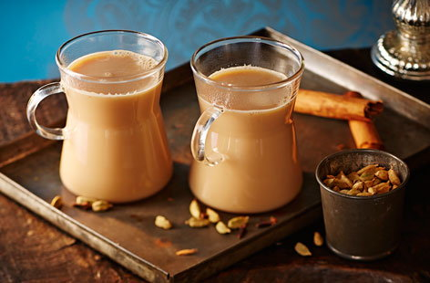 Conjure up the taste of New Delhi with this warming recipe for chai, a lightly spiced and aromatic milky black tea. Fresh ginger and spices are boiled in water, then tea, milk and sugar are added to taste.