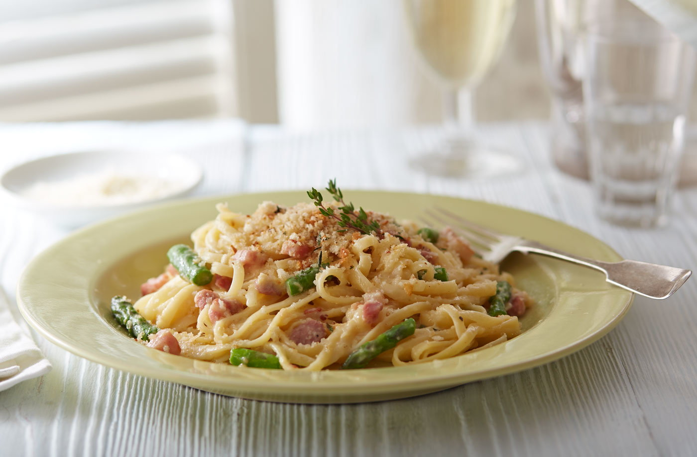 Pancetta and asparagus carbonara with thyme breadcrumbs recipe