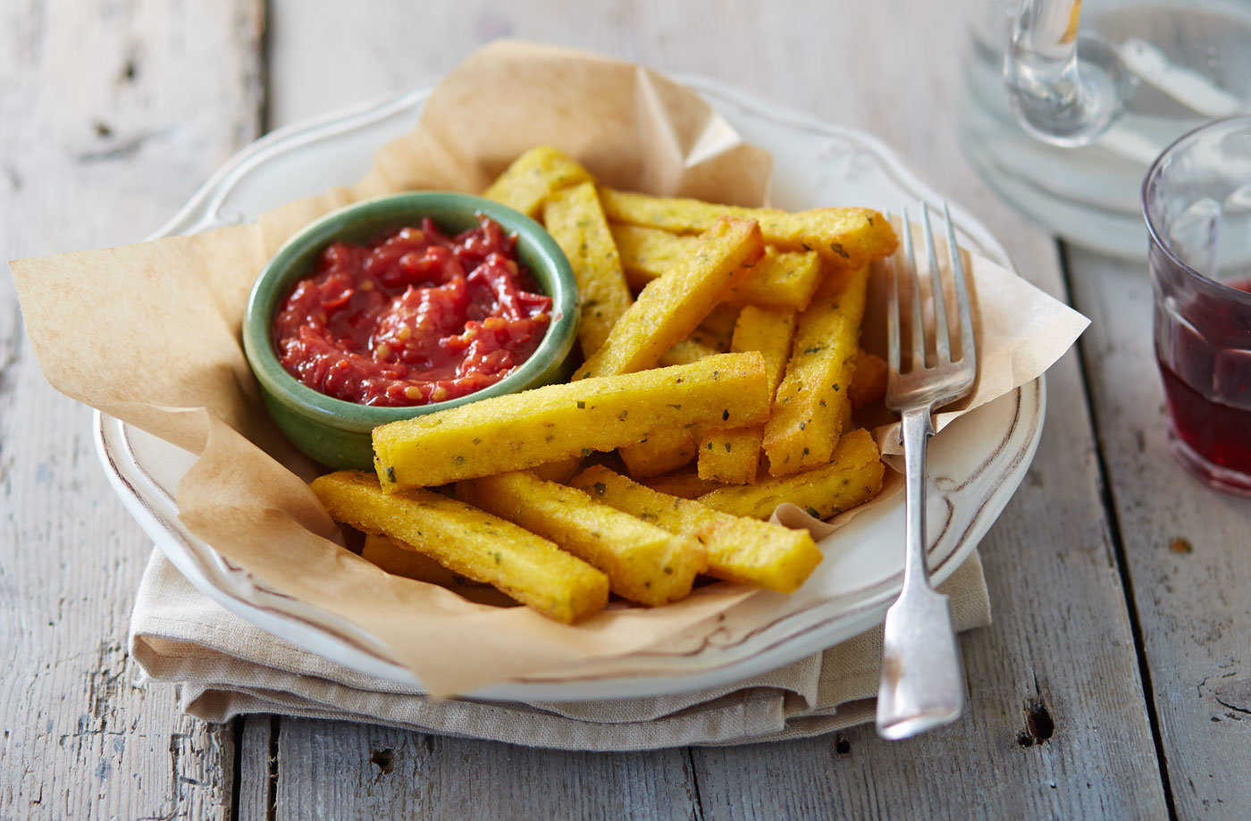 Polenta chips with Parmesan, herbs and a chilli-tomato relish recipe