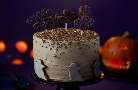 Cast a spell with this show-stopping Halloween cake that's guaranteed to make your party spooktacular. Kids will love the chocolate bat biscuits and ghoulish white chocolate ghosts, and the butterscotch cake is scarily delicious!