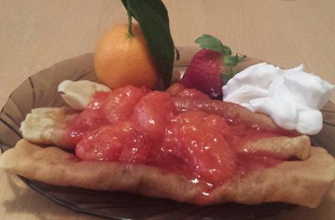 Crepes with Clementines-Strawberries syrup topped with whipped cream