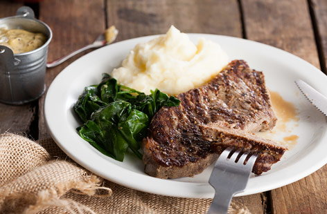 Steak with mash and wilted spinach