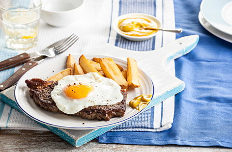 Steak with an egg on top