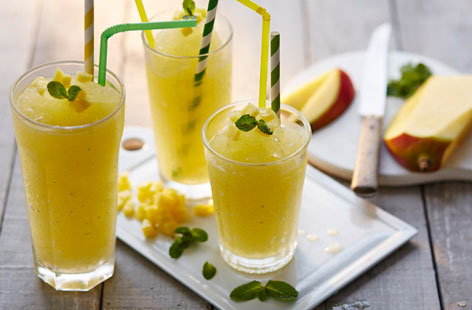 We've given the traditional slushie a grown-up twist with fresh mango, mint and rum.