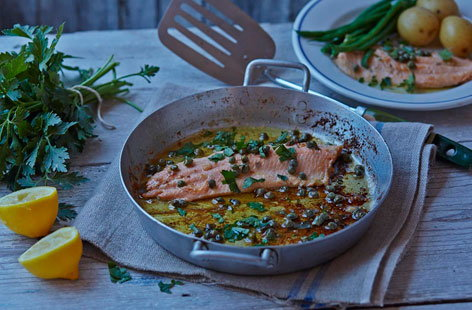 Impress your dinner guests with this pan-fried rainbow trout served with a lemony sauce, briny capers, and butter parsley