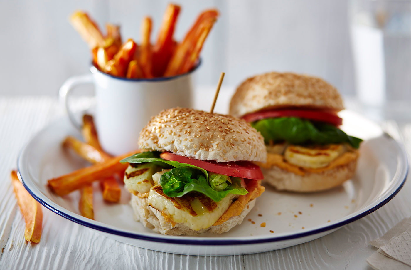 Halloumi burgers with red pepper houmous and sweet potato chips