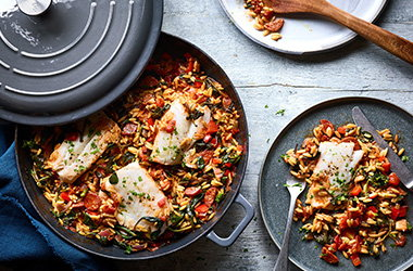 Baked chorizo orzo with white fish