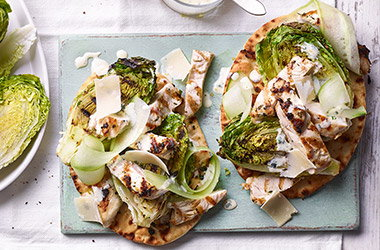 Grilled chicken Caesar salad with herby flatbreads