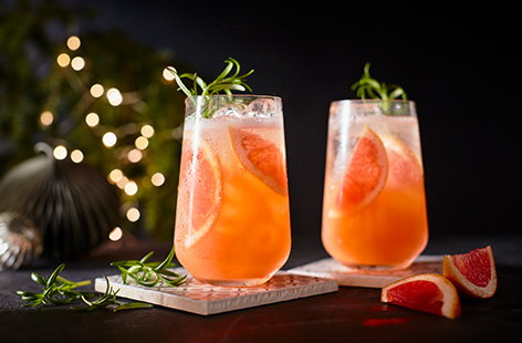 Give a classic white wine spritzer a citrus twist with this grapefruit spritz recipe. An easy festive cocktail for two, simply shake together white wine with tart grapefruit juice and fizzy tonic water and garnish with pretty pink grapefruit slices.