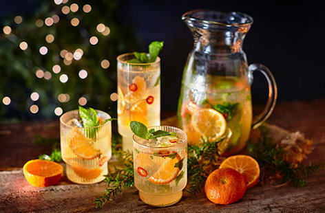 Try a new Christmas cocktail idea this year with this honeyed clementine and chilli smash. This easy white wine cocktail recipe combines sweet festive clementines with a touch of chilli and turns a bottle of white wine into a fizzy spritzer for sharing.