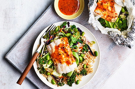 Frozen hake fillets pair well with fresh pak choi and an edamame and vegetable stir fry mix under a fiery soy, chilli and ginger dressing in this simple recipe