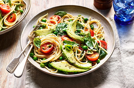 Slices of ripe avocado adds a luxurious, creamy texture to this veg-laden pasta dish