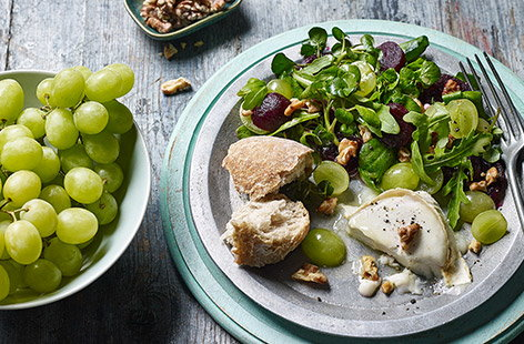 Baked goat's cheese with grape, walnut and beetroot salad