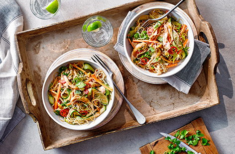 Got leftover chicken from a Sunday roast? Turn it into this quick bang bang chicken recipe - toss the chicken in a spicy ginger and peanut dressing along with plenty of fresh raw veg, chilli and rice noodles for an easy Chinese-inspired salad.