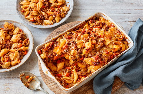 Spaghetti bolognese is a timeless family favourite - make it even better with this hearty bolognese pasta bake recipe. With plenty of hidden veg and a melting cheese topping, this is the perfect wallet-friendly way to feed the whole family.