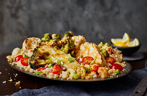 Try this Middle Eastern-inspired roasted broccoli and cauliflower couscous for your next vegetarian dinner. The veg is sliced into thick steaks and brushed with garlic and lemon houmous to caramelise whilst roasting on top of fluffy couscous.